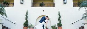 Couple leaning over and kissing outside on stairs