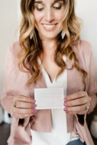 Jessica Schuler with her new business card